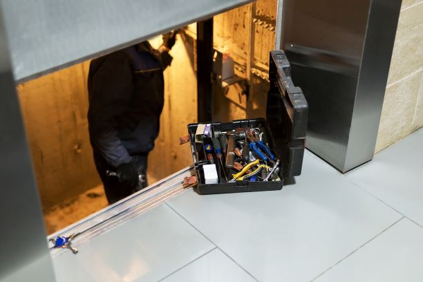 Elevator maintenance being performed